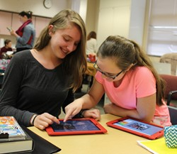 Photo of Middle School Students Using iPads