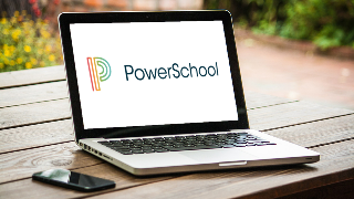 Laptop computer showing PowerSchool logo for course scheduling