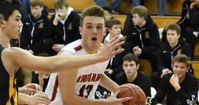 Male student playing basketball