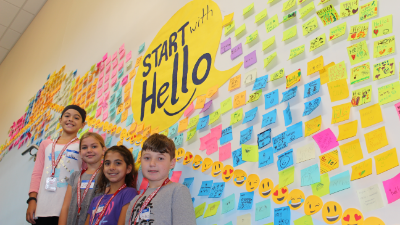 Start with Hello Post-it wall and students at McIntyre Elementary