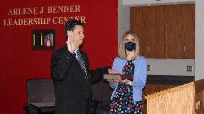 Dr. Patrick Mannarino with Mrs. Allison taking oath of office as superintendent