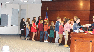 Students share 'Spirit of Giving' at school board meeting