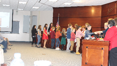 Students shake hands with school board members during the Dec. 3 Board of Education meeting