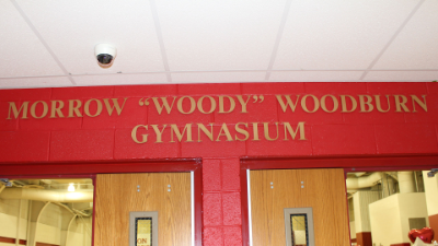 "Sign bearing Morrow ""Woody"" Woodburn's name outside North Hills Middle School gymnasium"