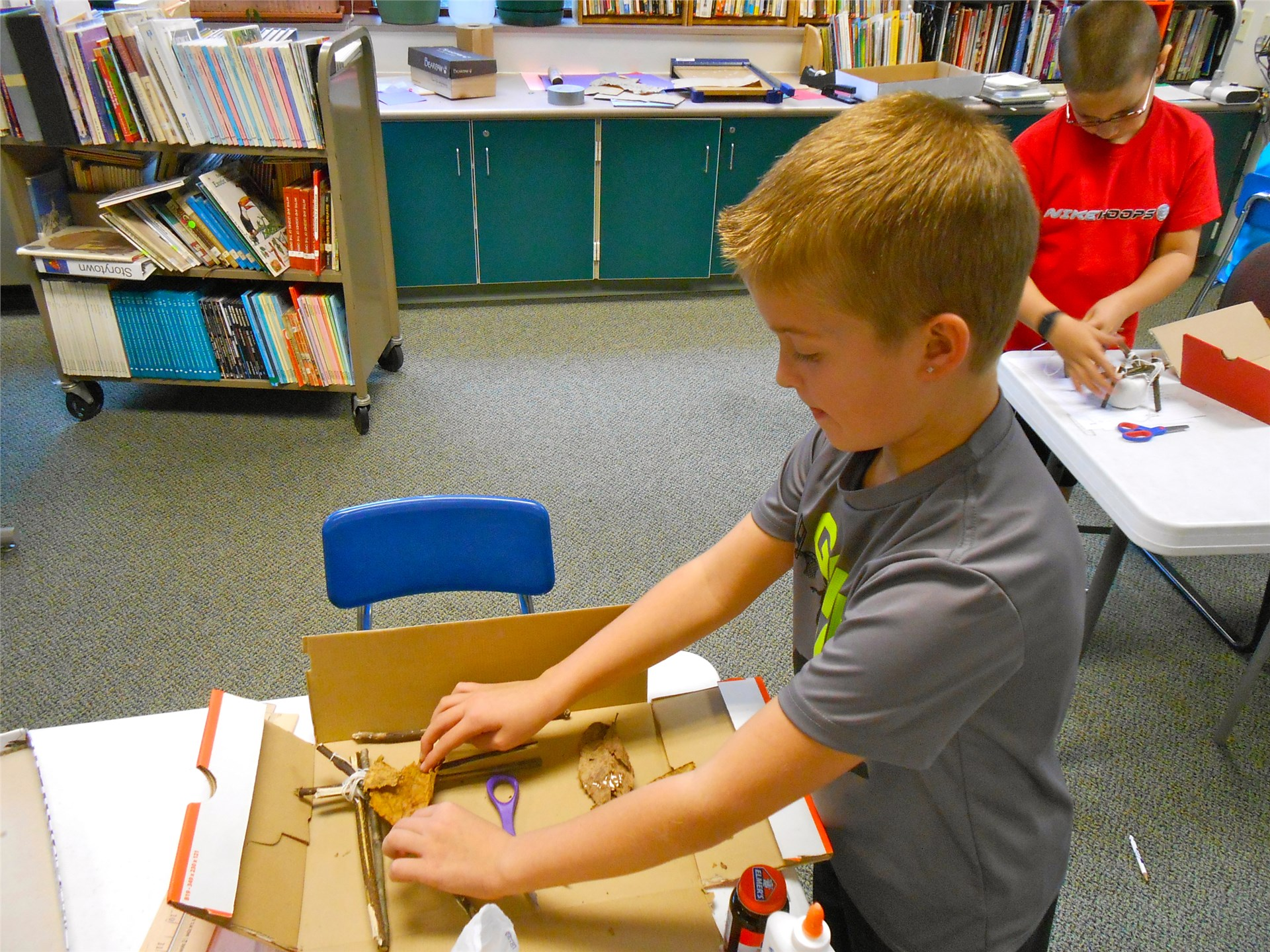 Fourth graders create models of Native American structures