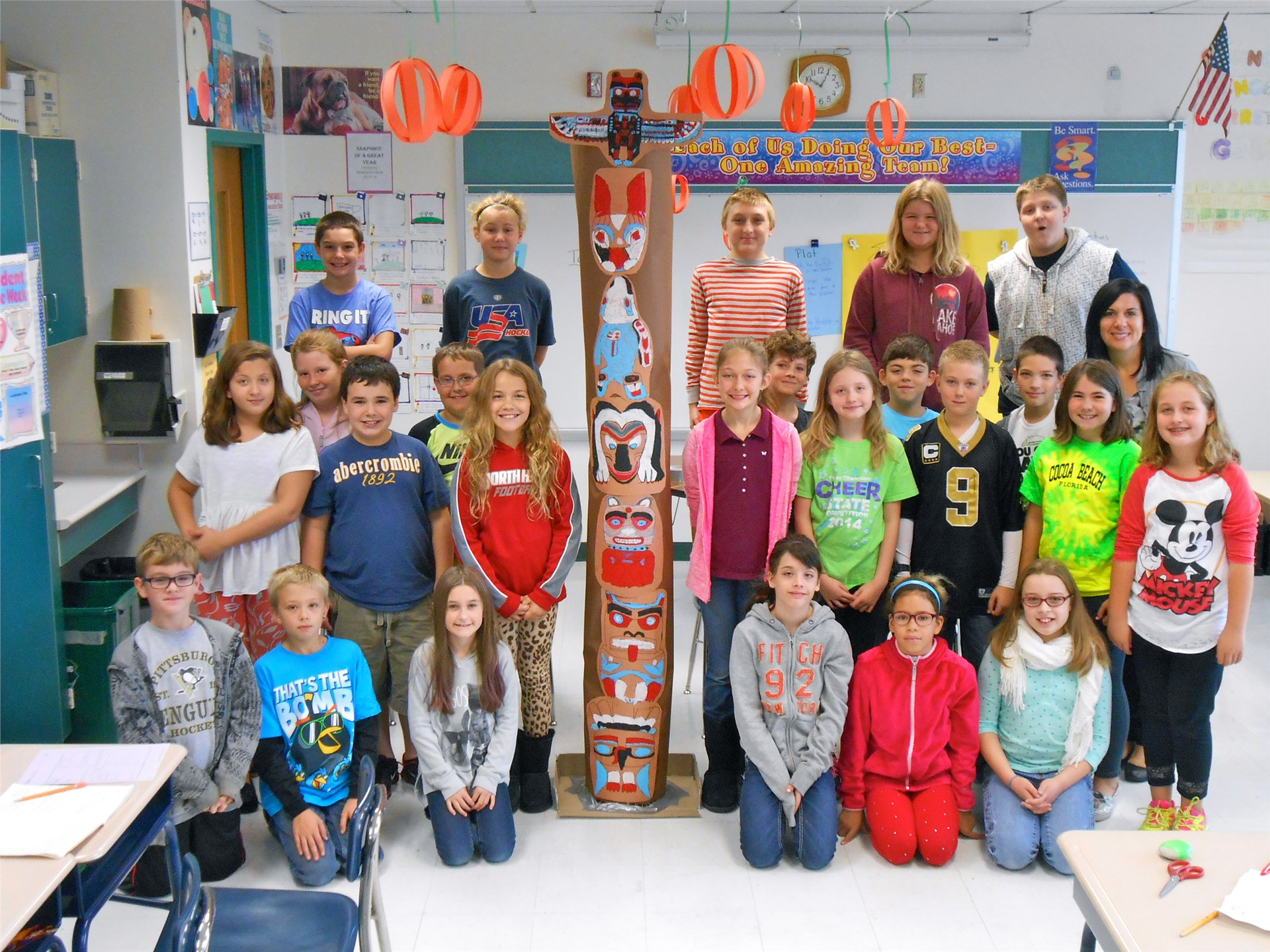 grade 6 constructs large totem poles
