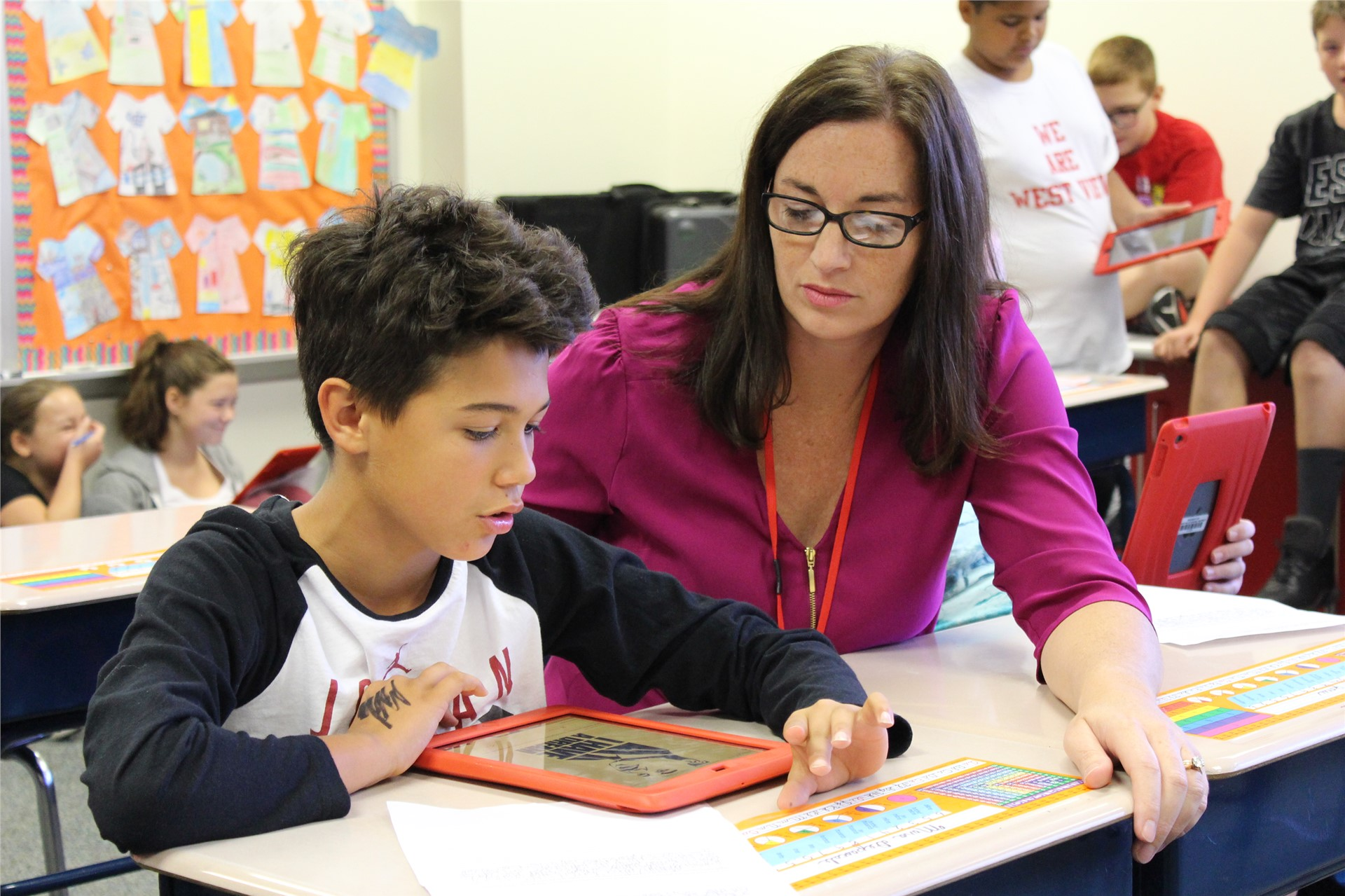 Student and Teacher Using iPad