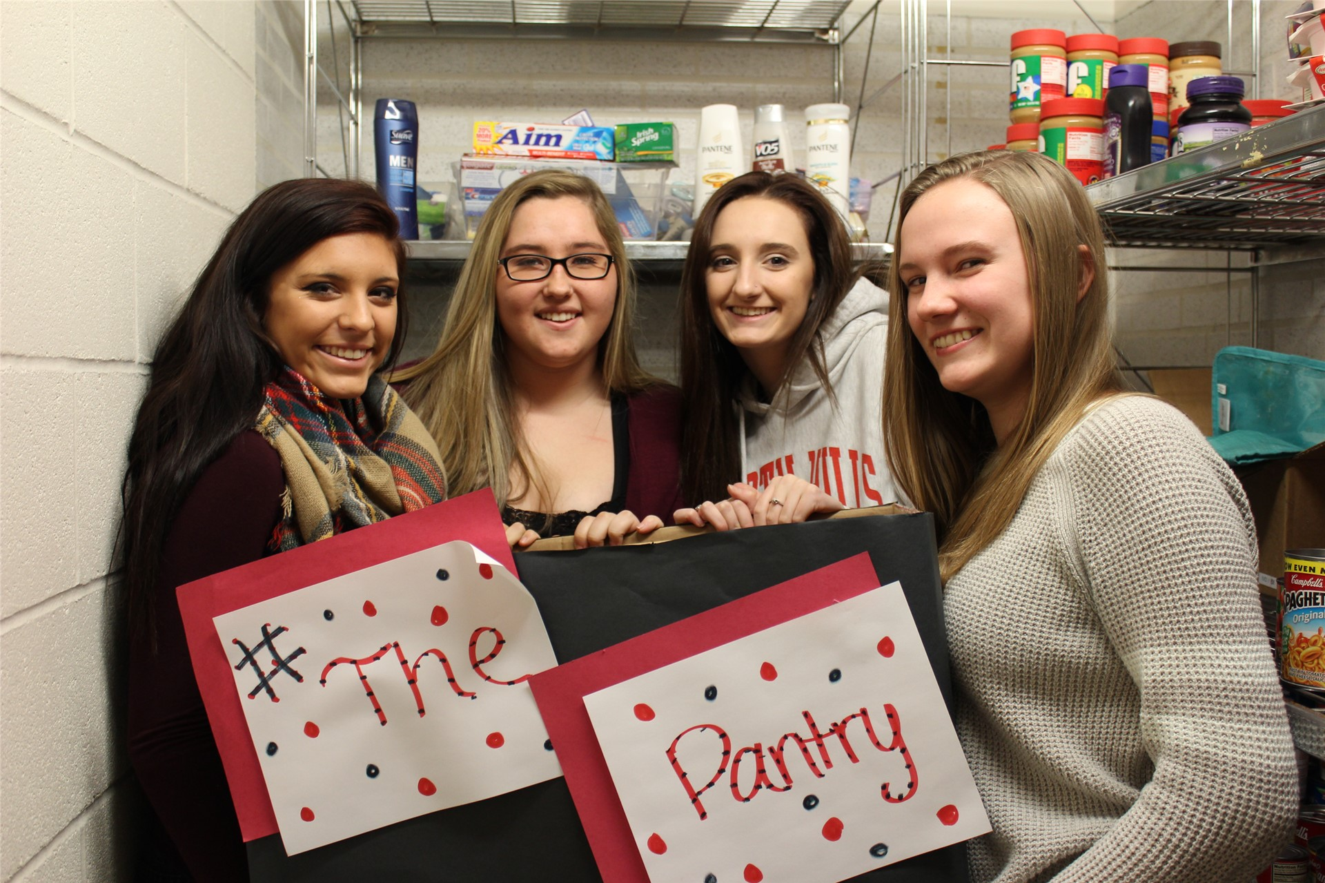 High School Students Stocking The Pantry