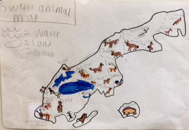 Third graders share knowledge of foreign countries.