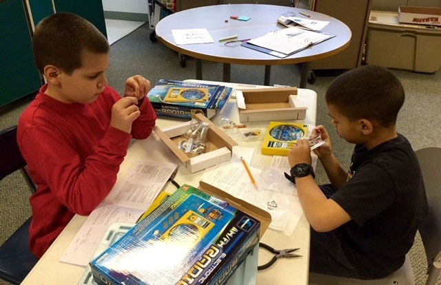 Students build AM-FM radios.