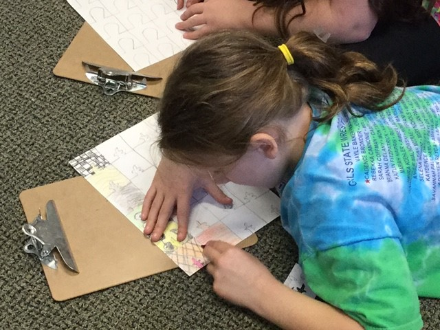 Students create designs with mathematical patterning.