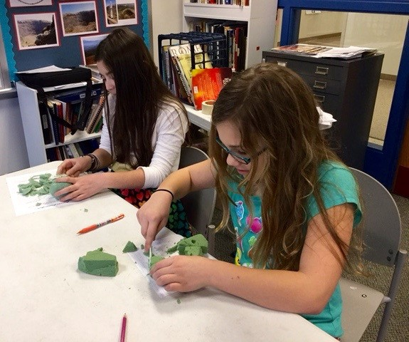 FIfth graders create sculpture.