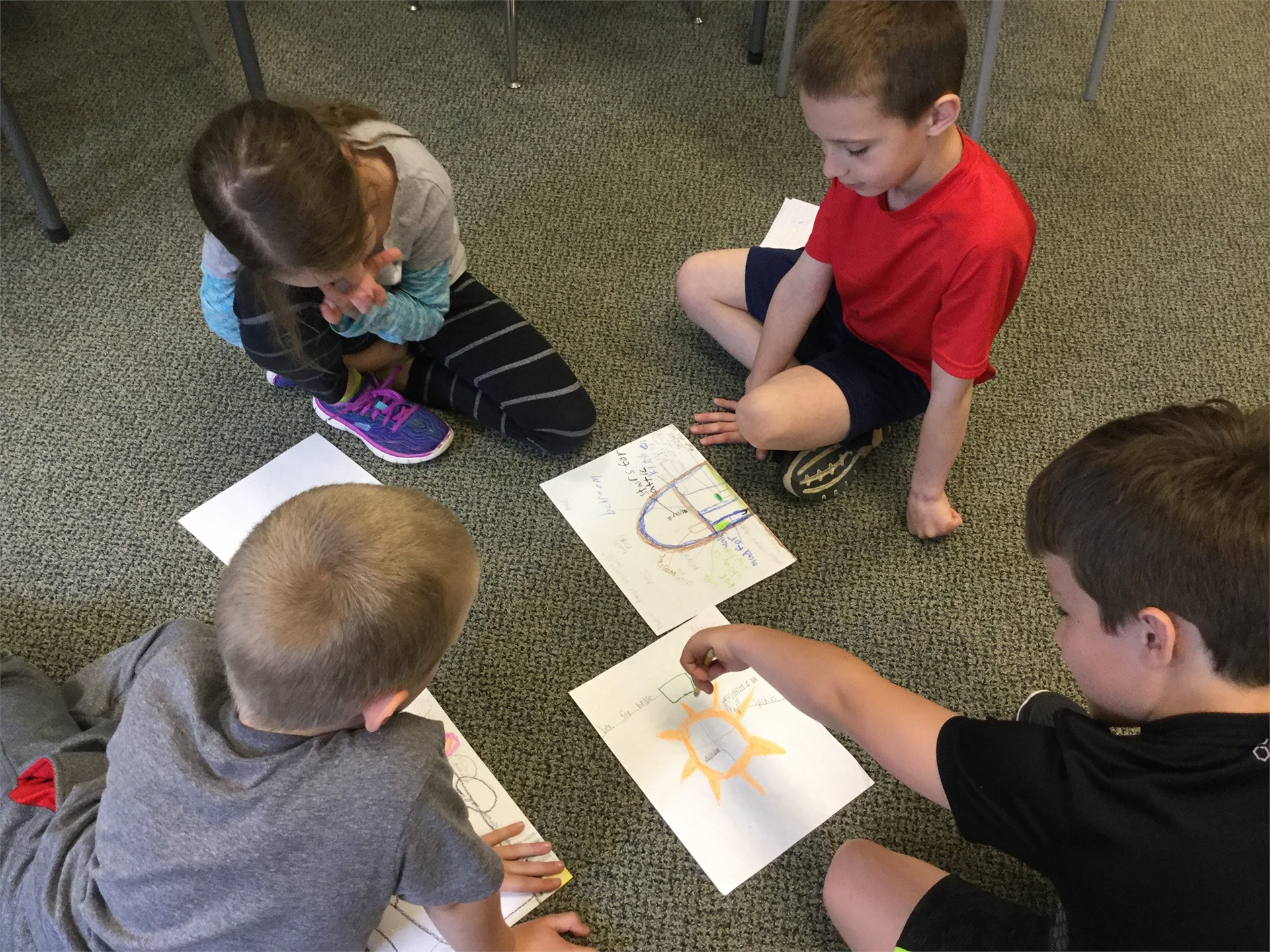 How animals might design houses. Students share their plans.