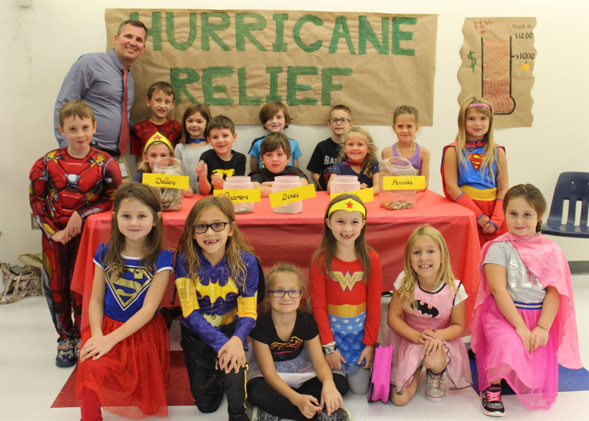 Photo of West View Elementary Students Dressed as Superheroes for Hurricane Relief Fundraiser