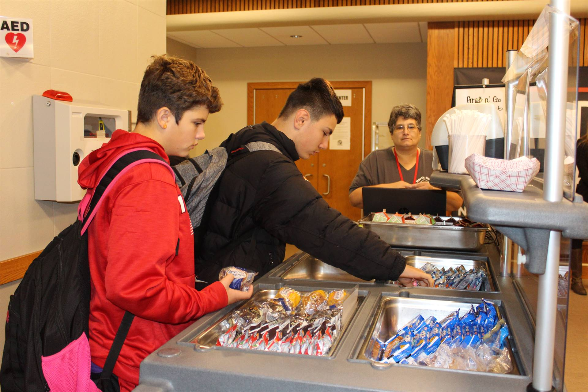 Photo of Middle School Boys Purchasing Breakfast from New Cart