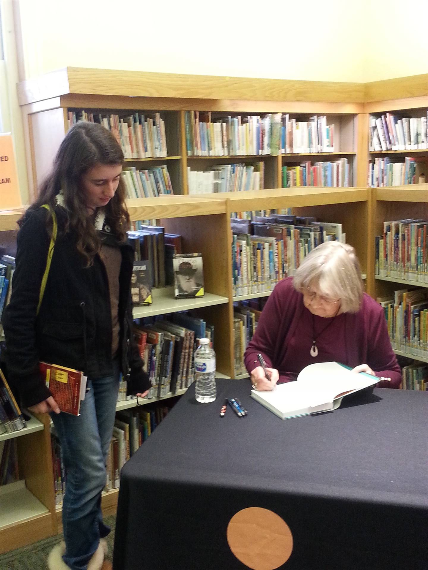 Katherine Paterson signs a book.