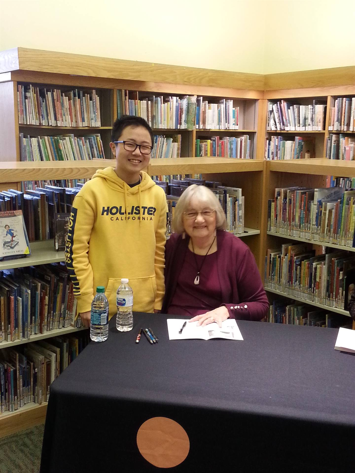 Katherine Paterson poses with a student.