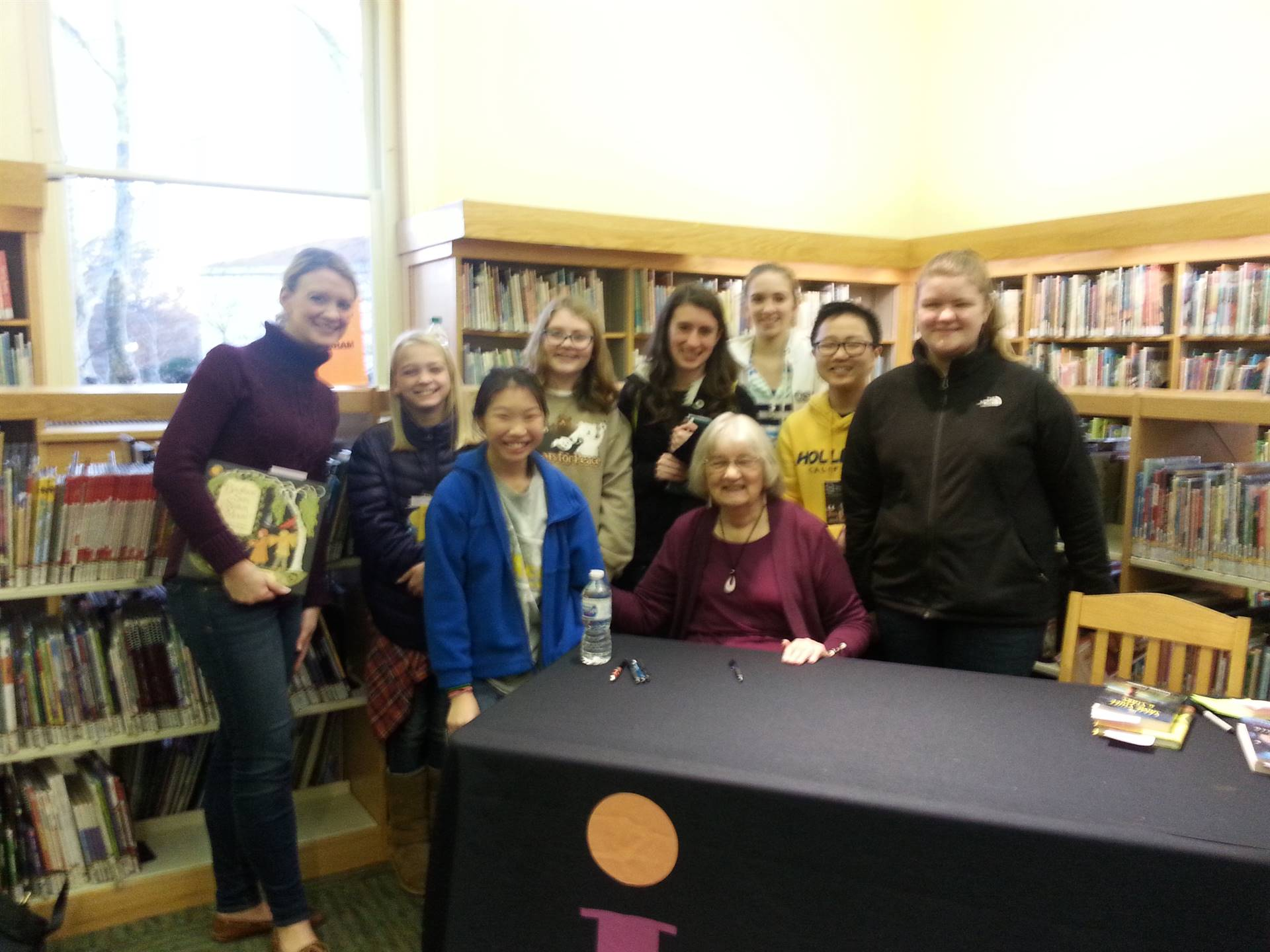 Katherine Paterson poses with students and a teacher.