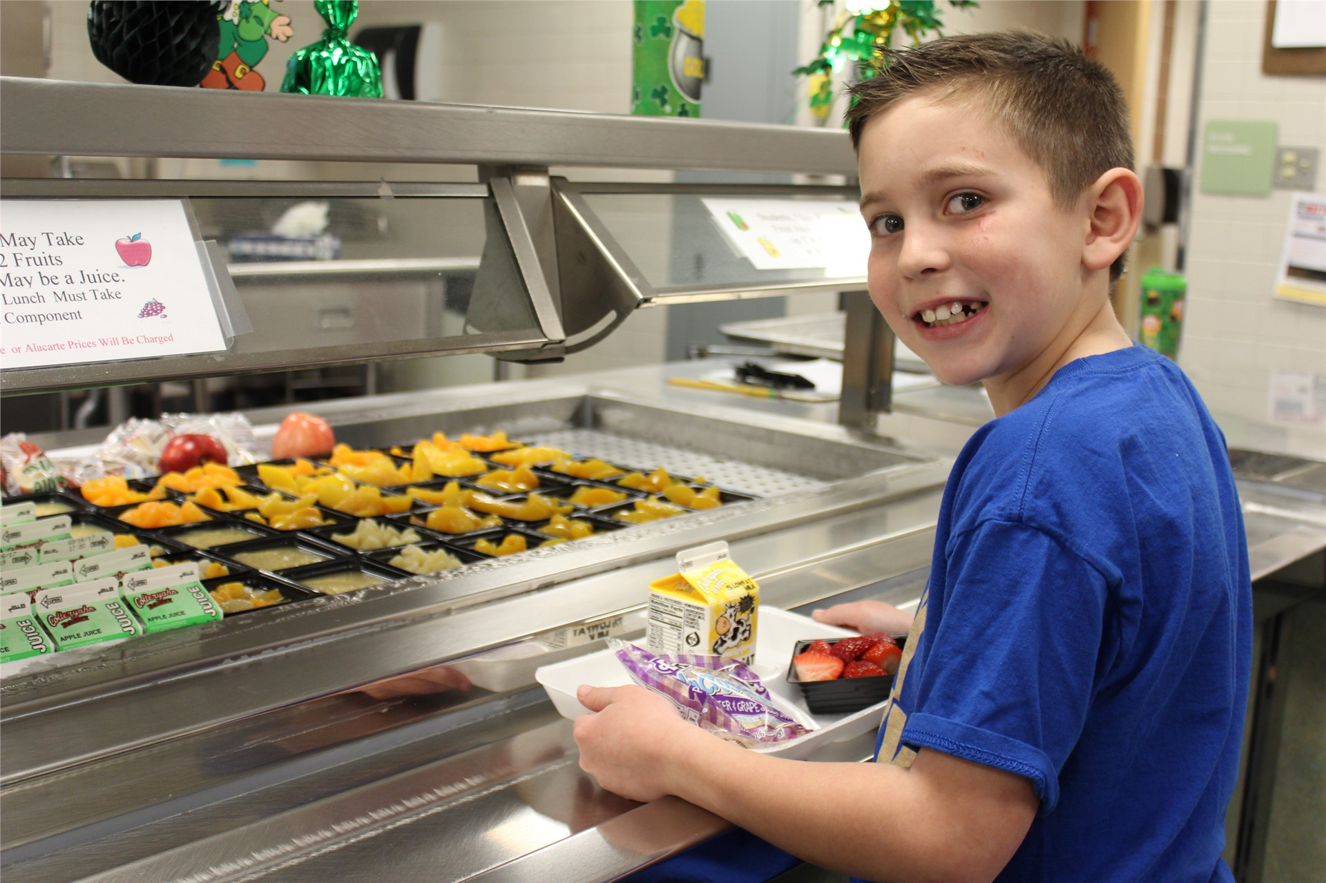 Elementary Student with Lunch Tray and Healthy Options