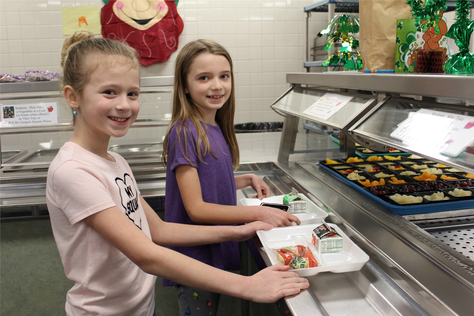 Elementary Students with Lunch Trays and Healthy Options