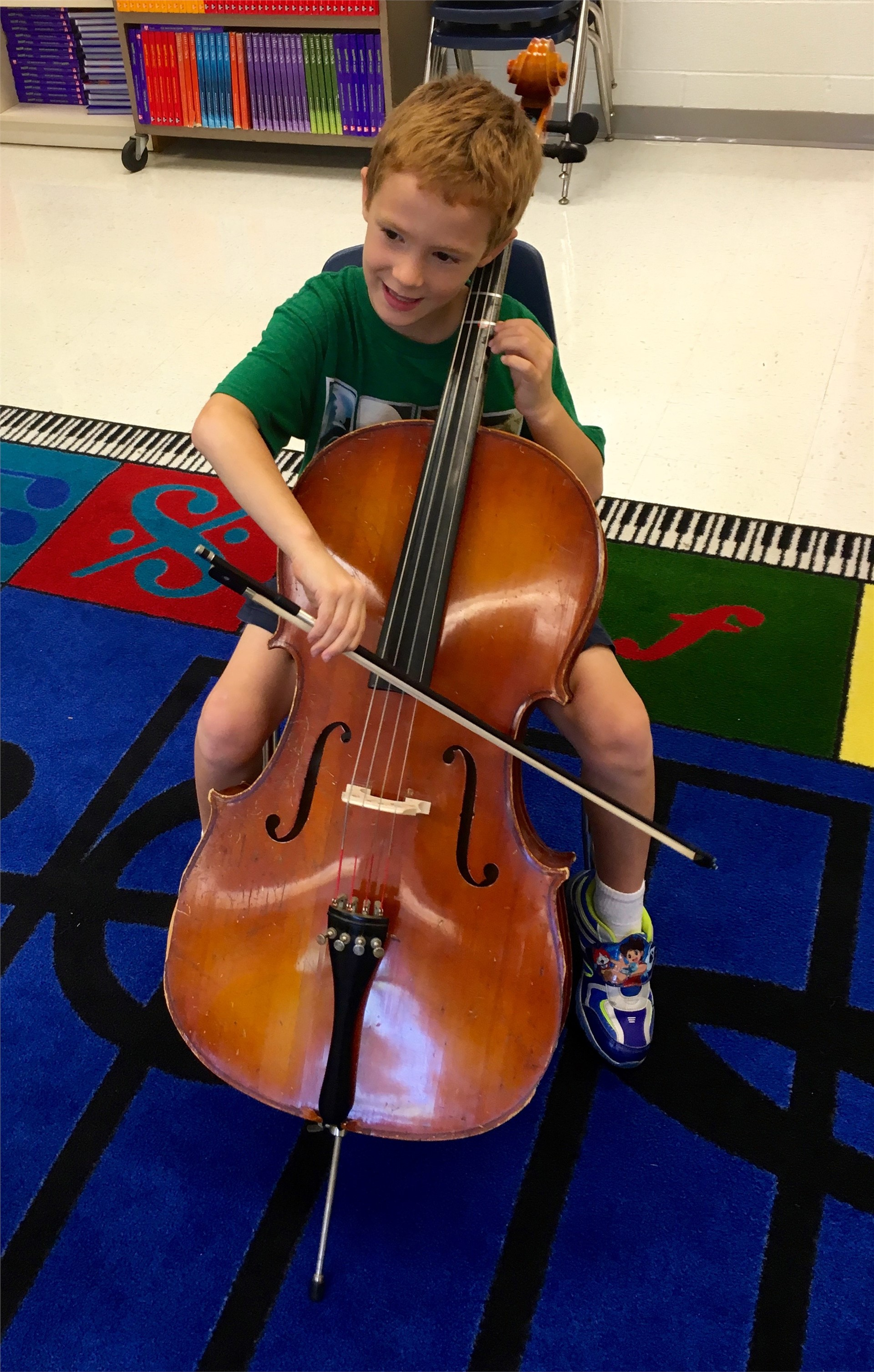Trying out a cello.