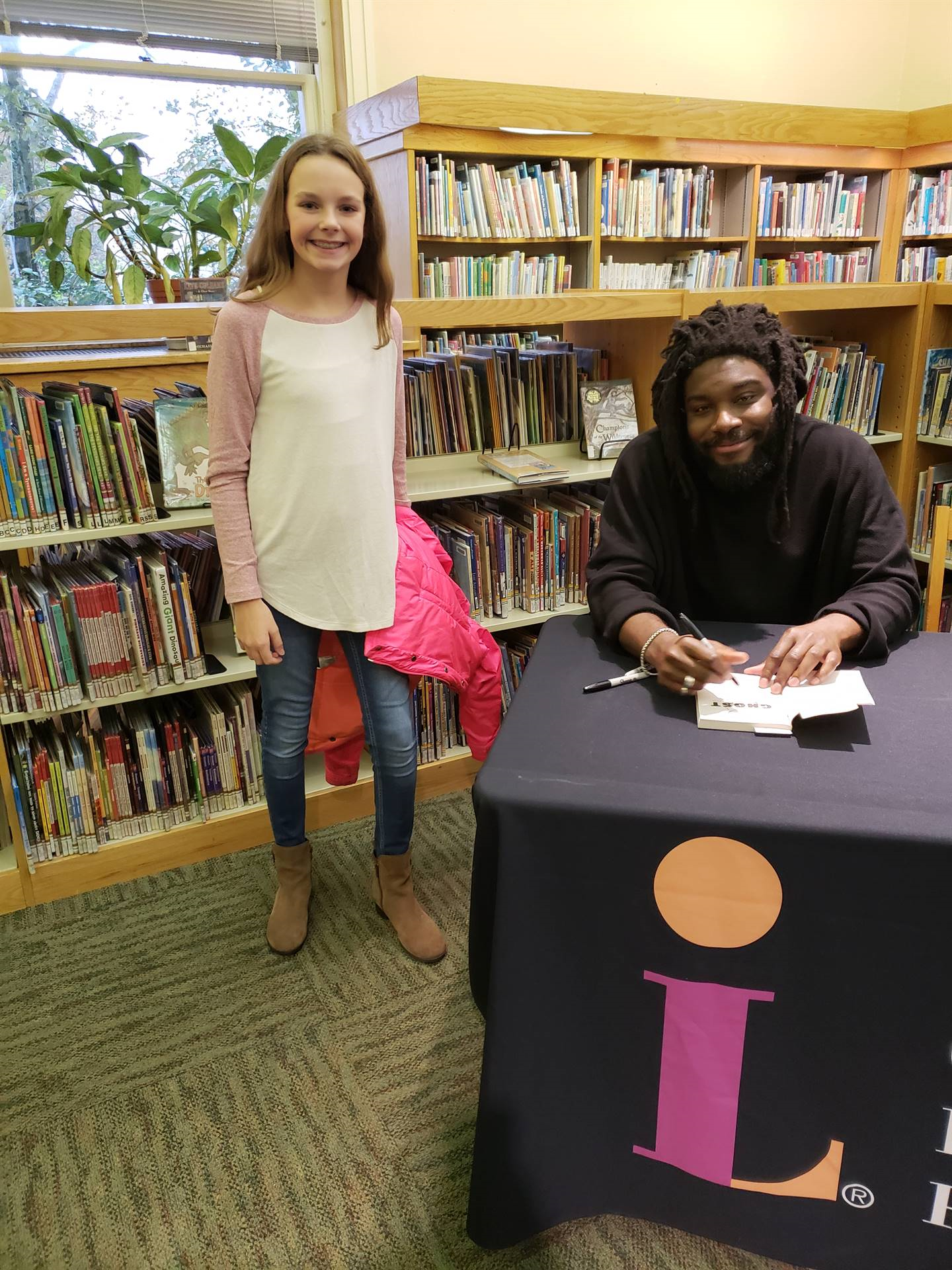 Jason Reynolds and student