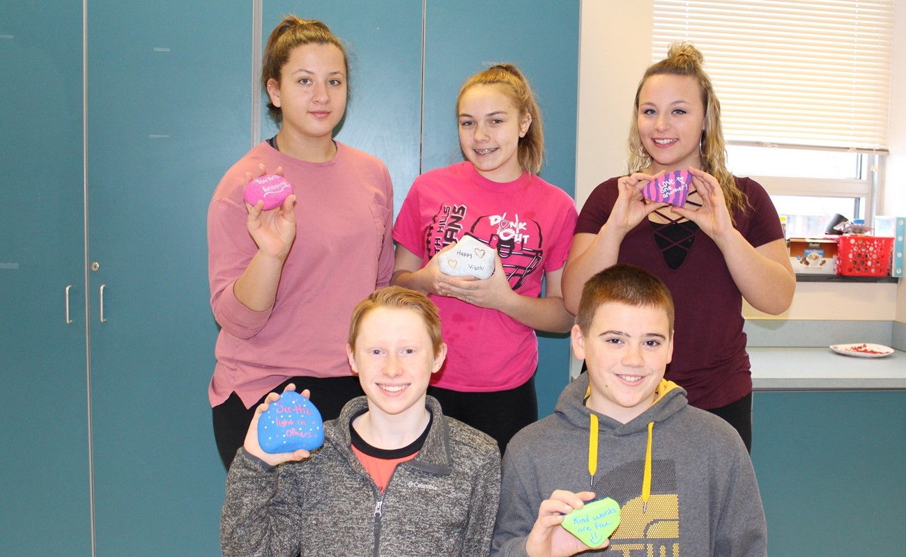Middle School Students with Kindness Rocks
