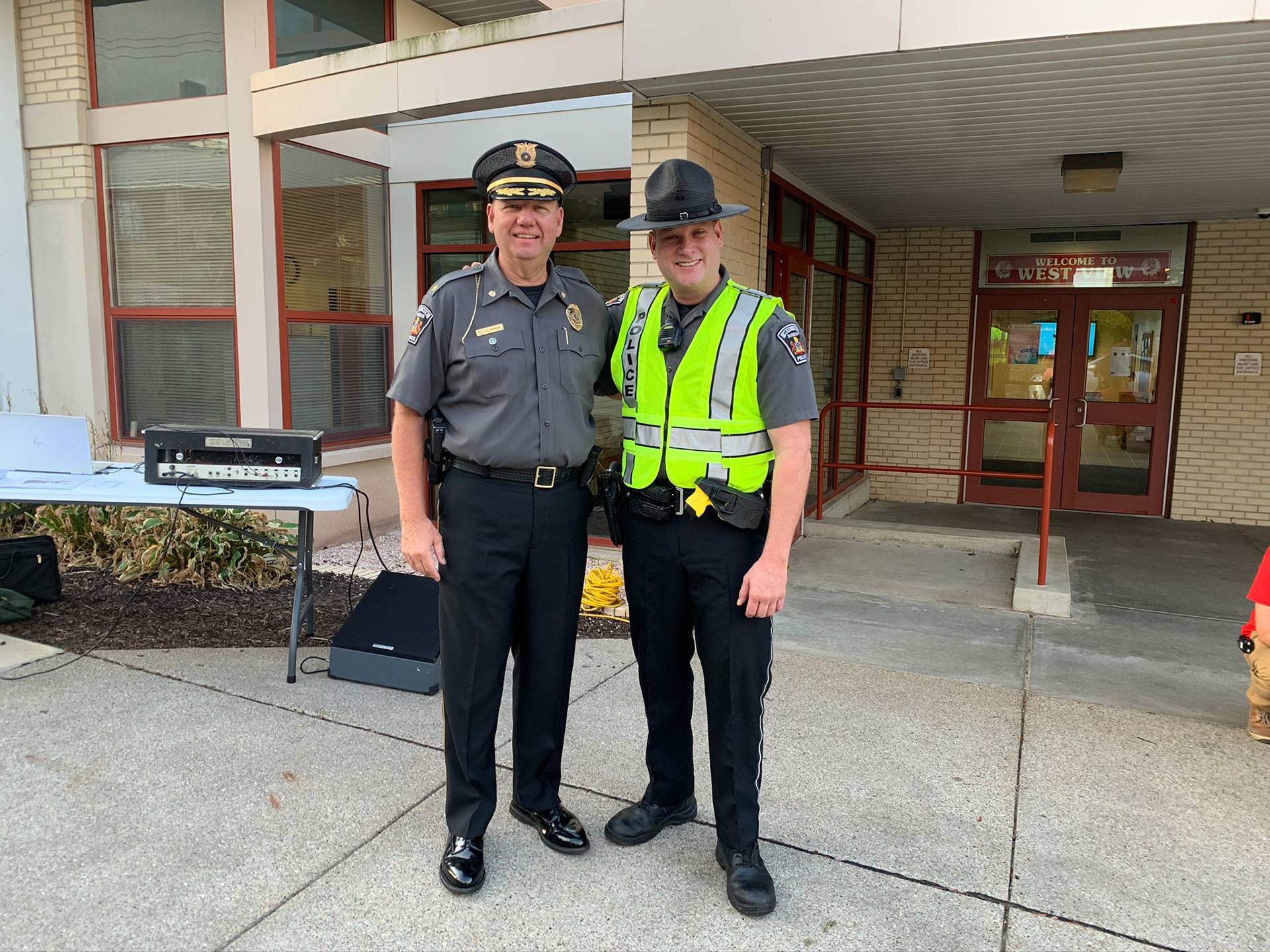 Two West View police officers at West View Elementary for International Walk to School Day at West V