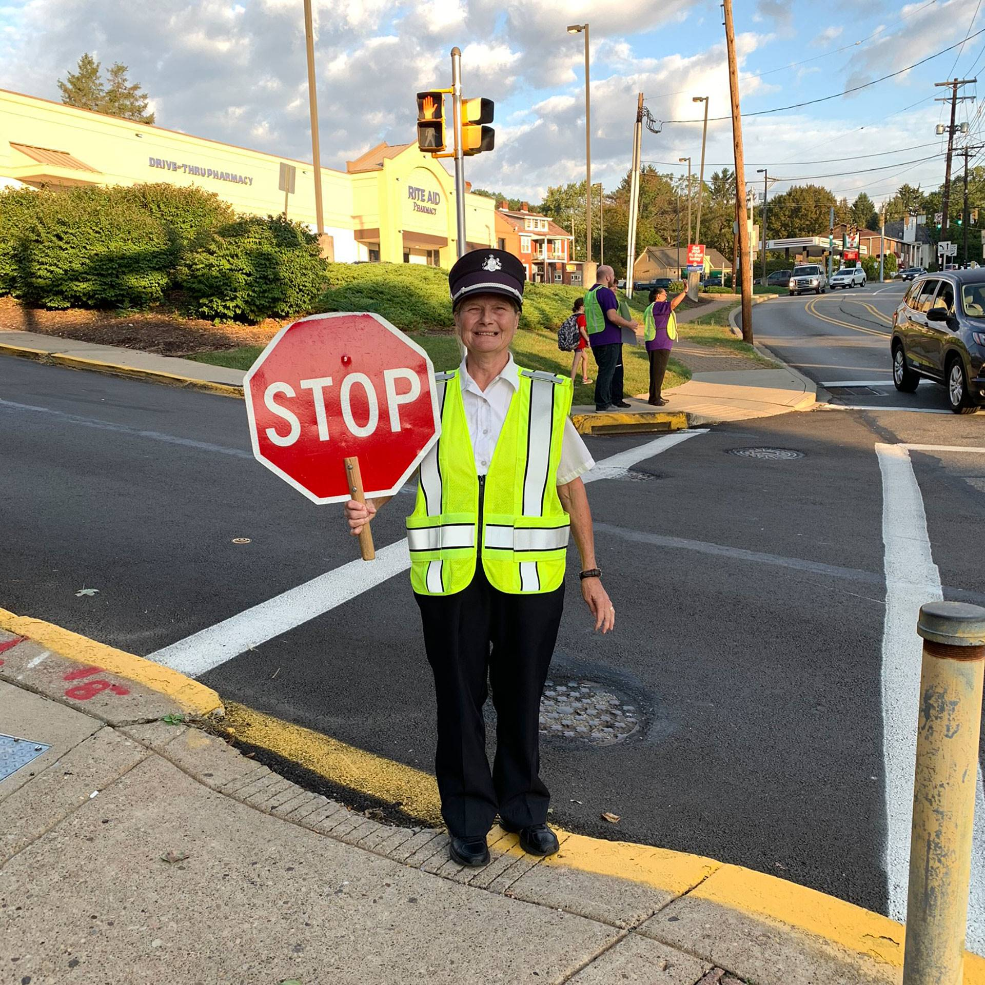 A crossing guard posing on International Walk to School Day on Oct. 2, 2019
