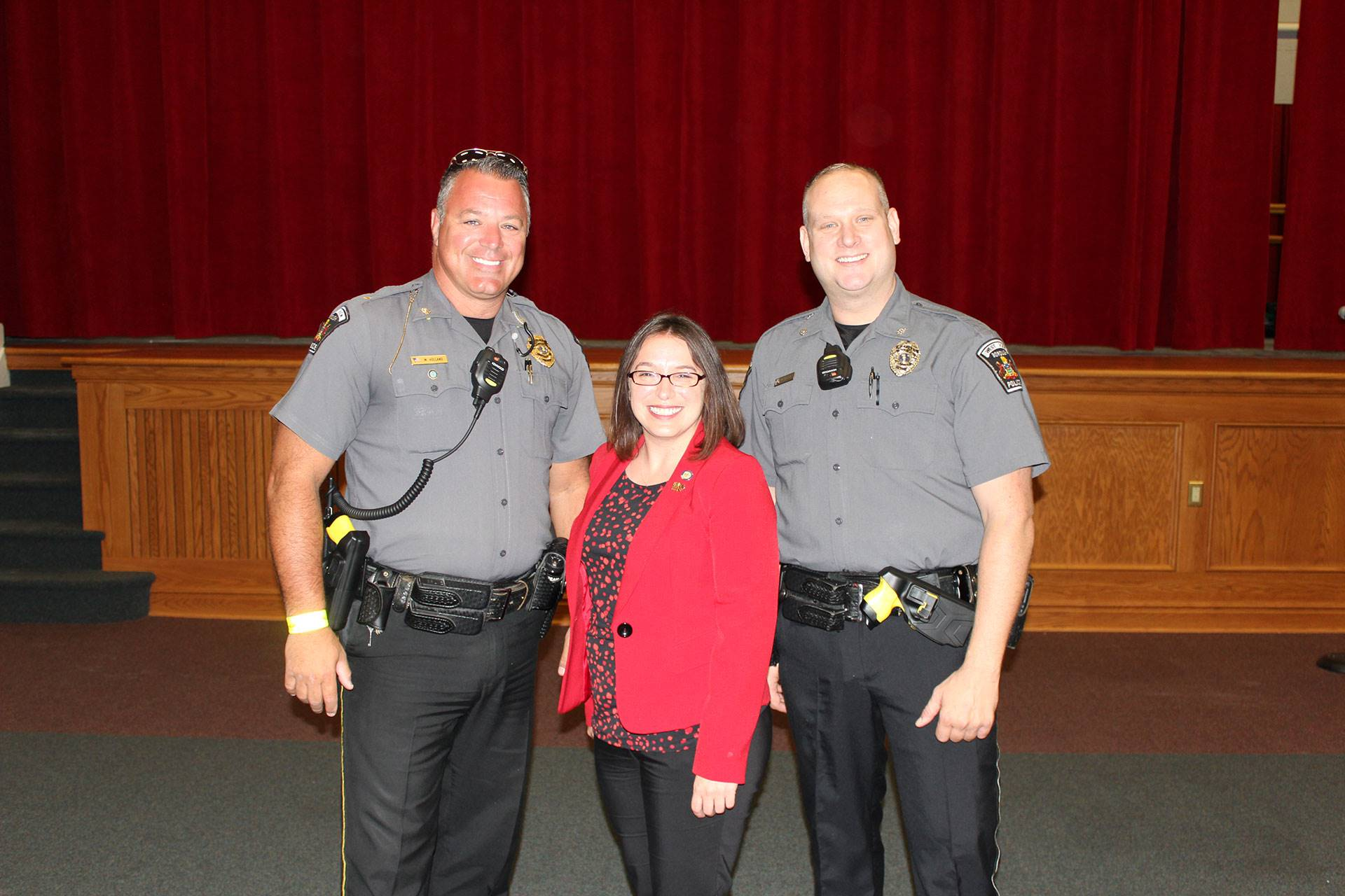 Two West View police officers with state Senator Lindsey Williams