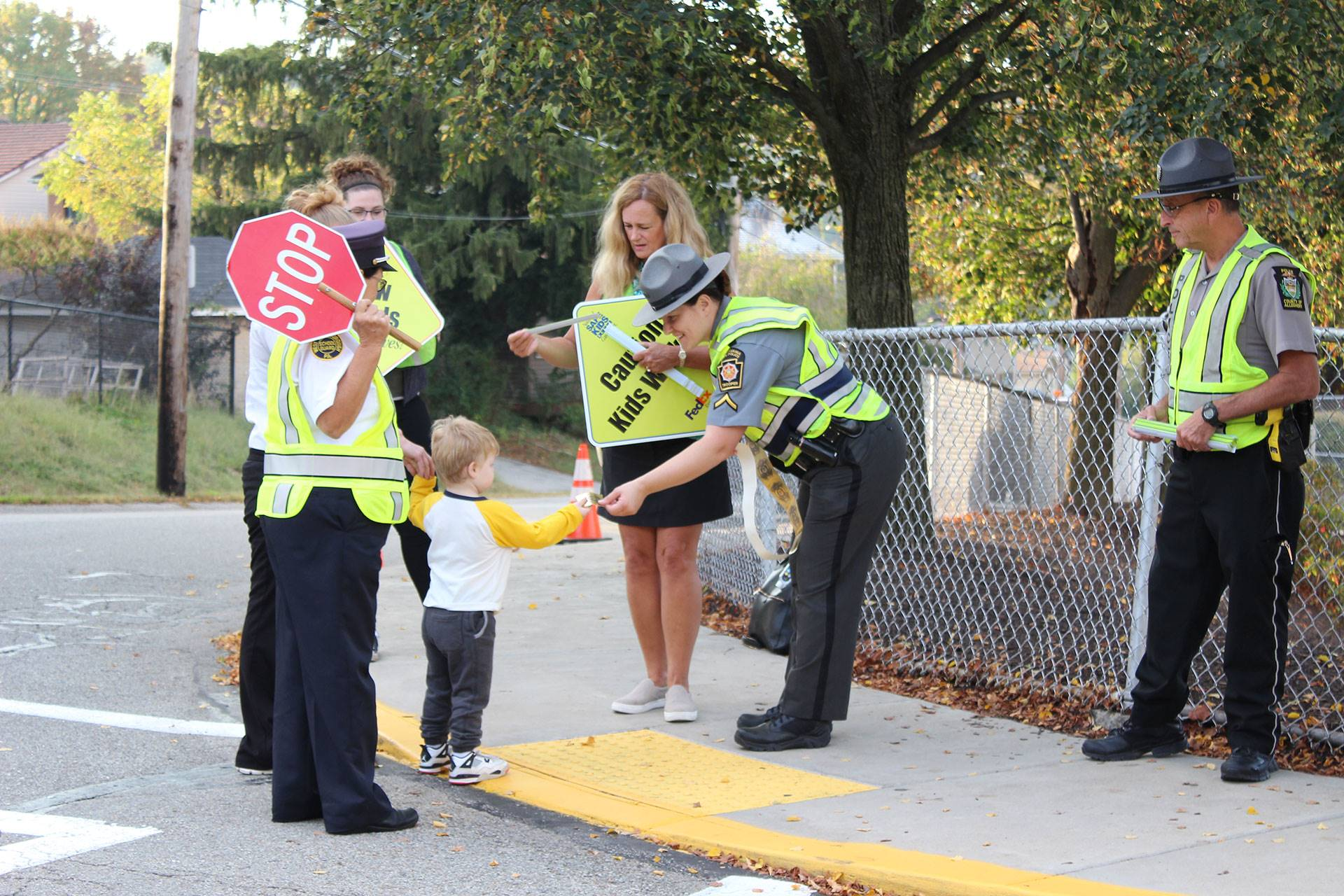 A group of crossing guards and officers at West View Elementary School on Oct. 2, 2019