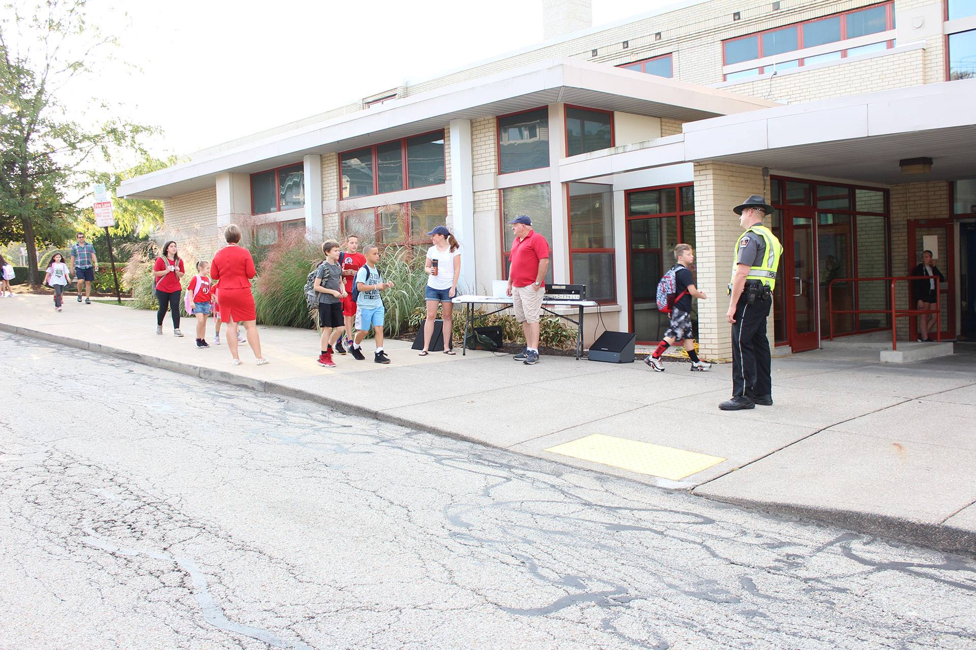 Students walking into West View Elementary School on International Walk to School Day