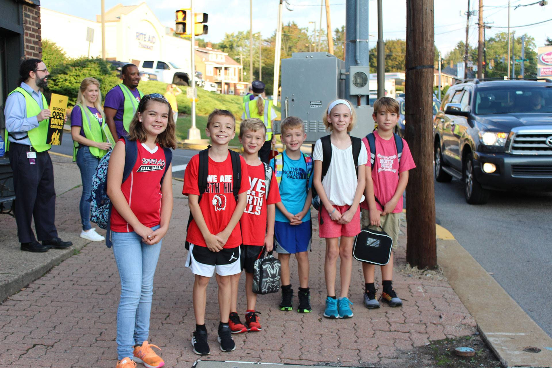Students preparing to cross the street in front of West View Elementary School
