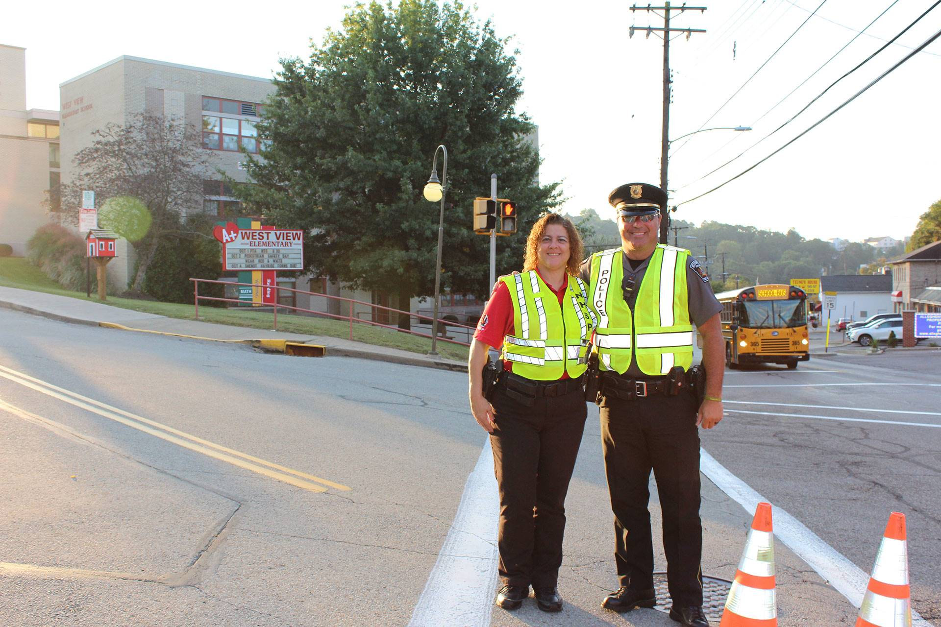 Police officers in front of West View Elementary School on International Walk to School Day