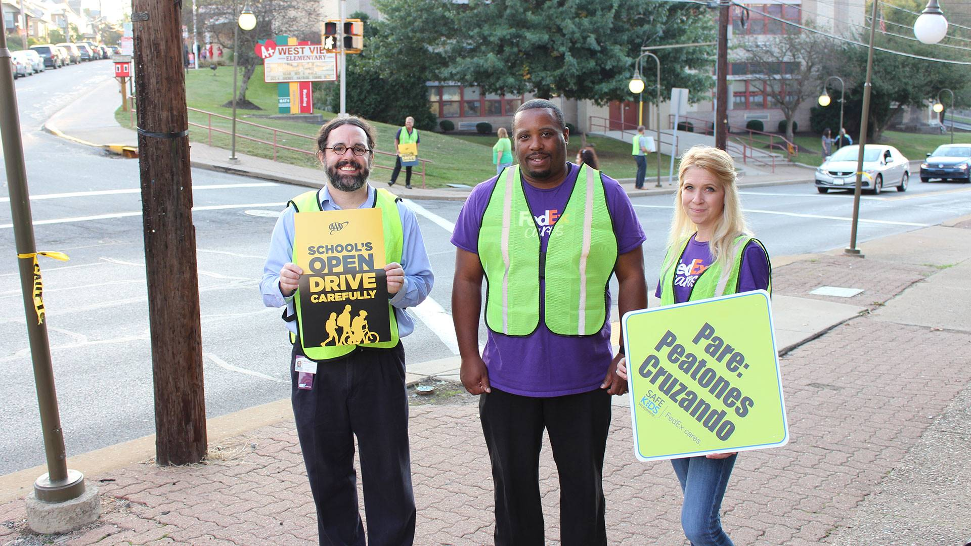 FedEx employees help keeps students safe on International Walk to School Day