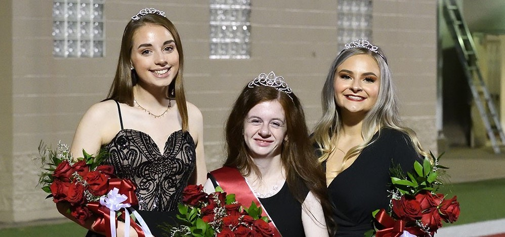Homecoming Queen Chloe Wiseman (center), first runner-up Averie Peet (right) and second runner-up Katie Swab