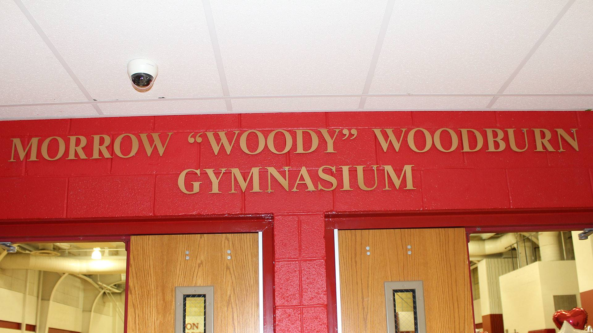 """Sign bearing Morrow """"Woody"""" Woodburn's name outside North Hills Middle School gymnasium"""