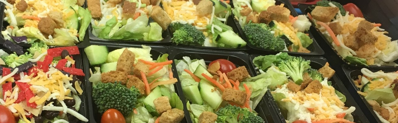 Tray of salads for student lunches