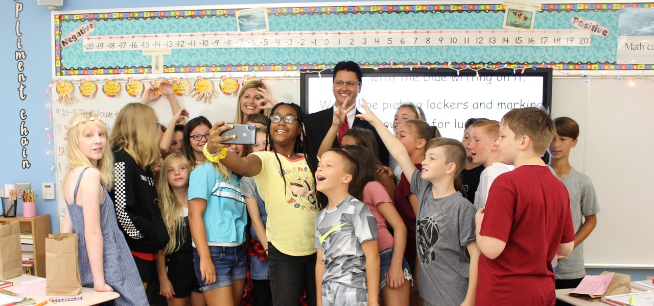 Superintendent Dr. Patrick Mannarino taking a selfie with students on the first day of school