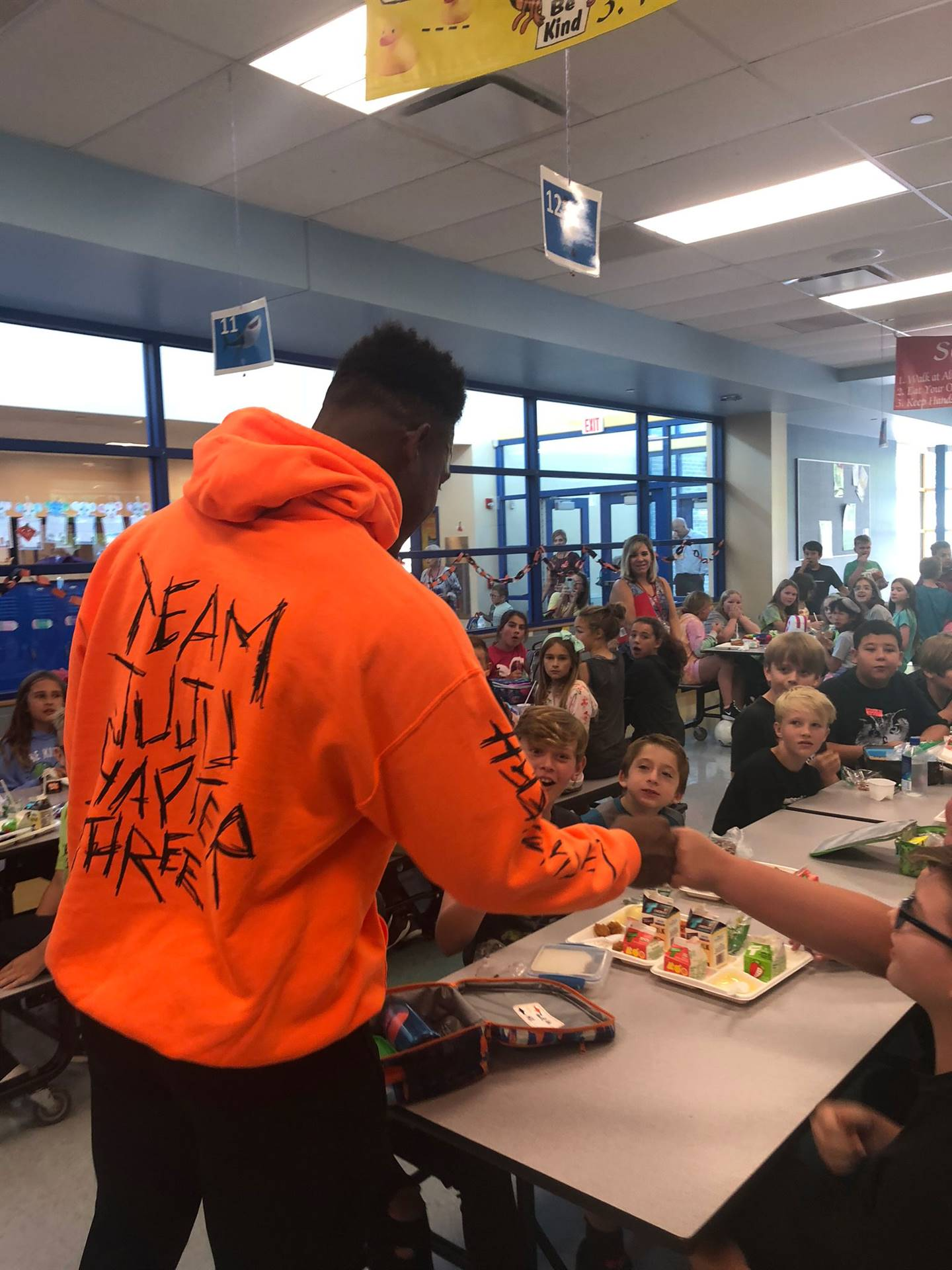 JuJu Smith-Schuster visiting with students at Ross Elementary School