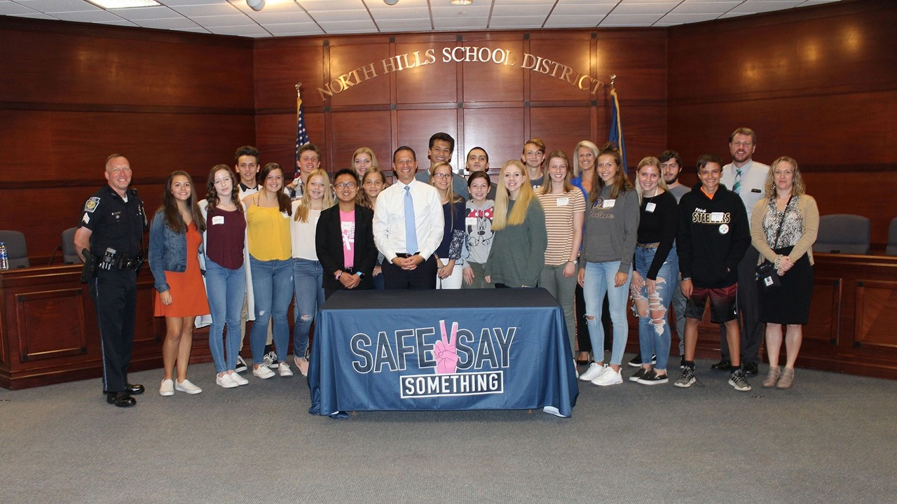 Pennsylvania Attorney General Josh Shapiro poses with North Hills High School students following a Safe2Say roundtable discussion.