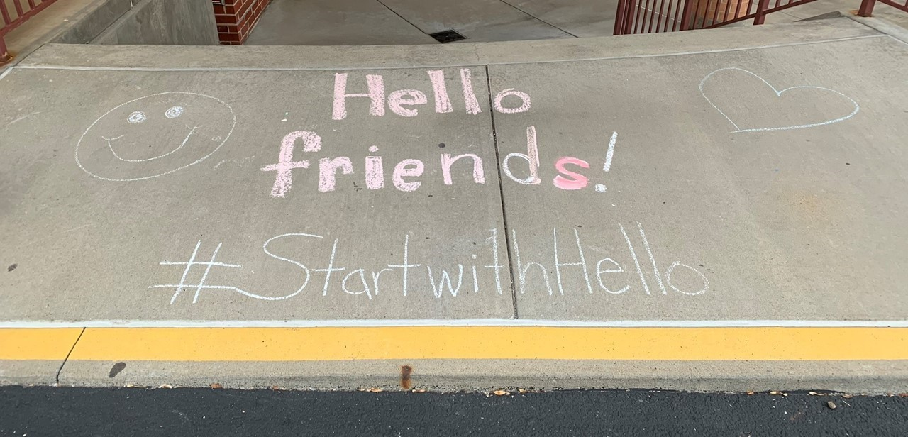 Start with Hello chalk art outside of Highcliff Elementary School