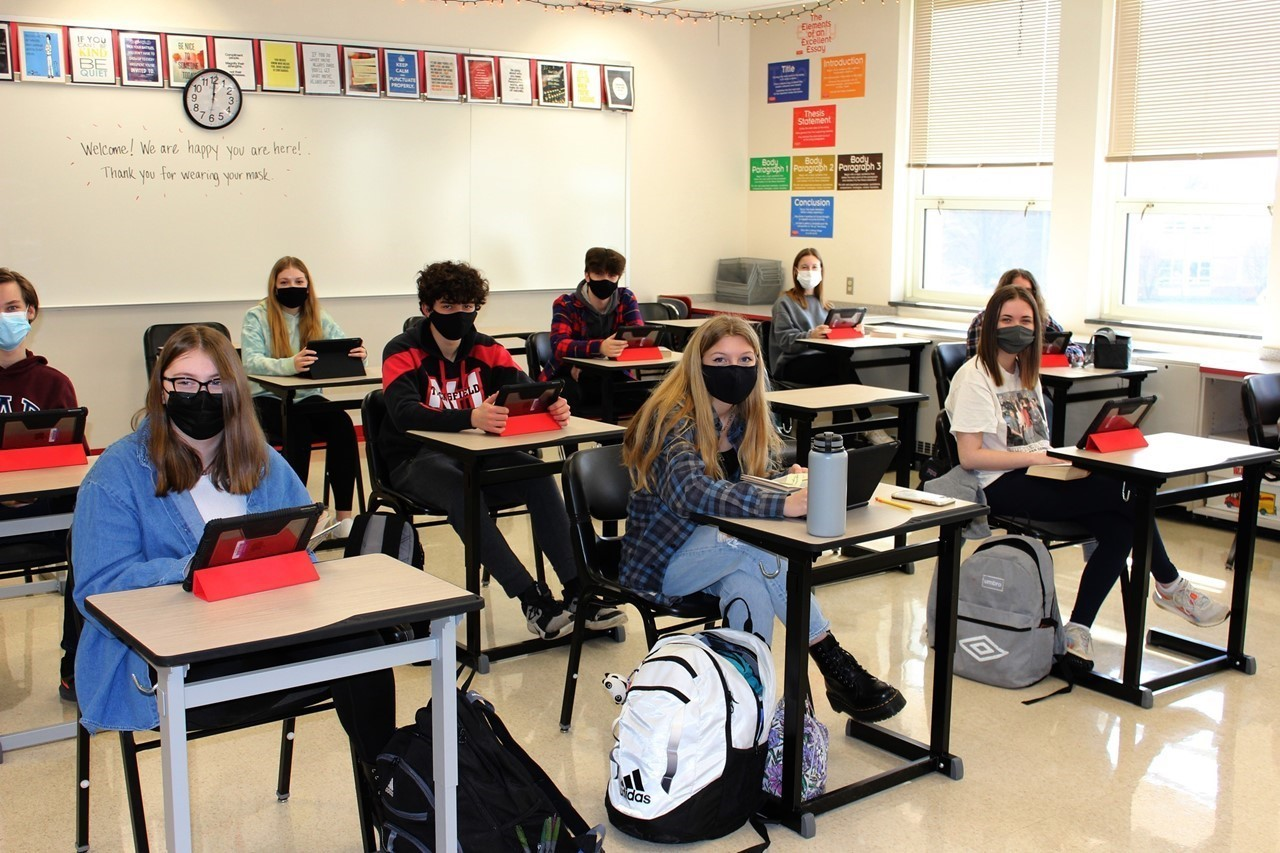 North Hills High School students in masks seated in classroom