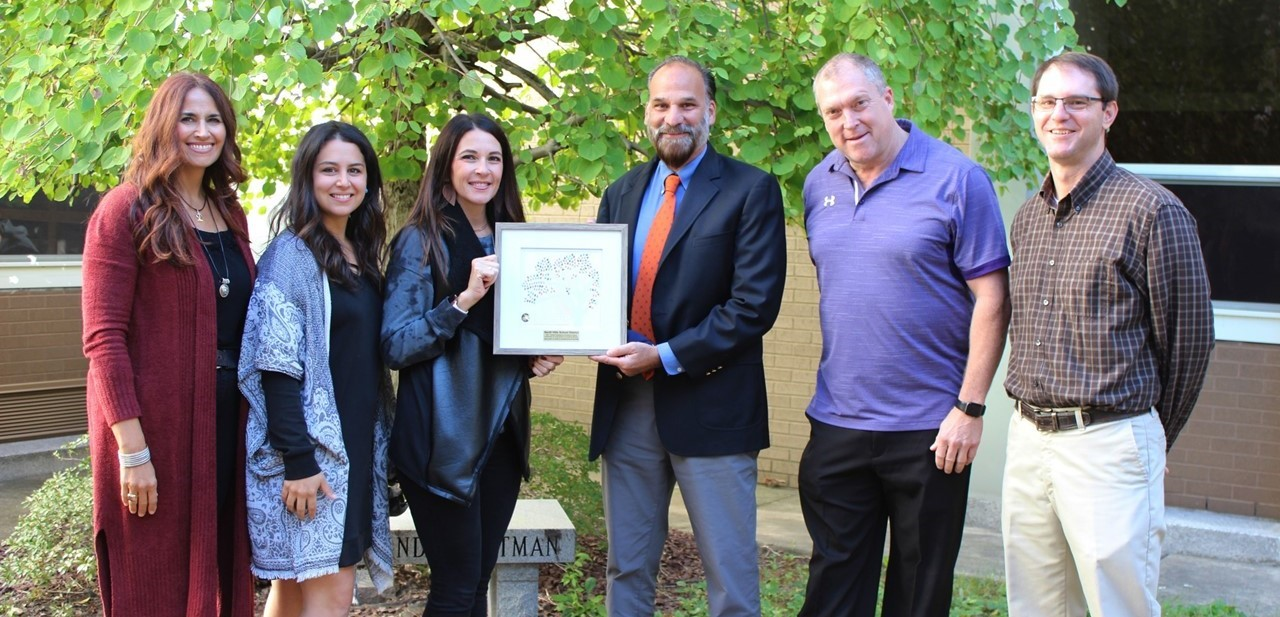 NHSD psychologists, counselors and social workers holding award
